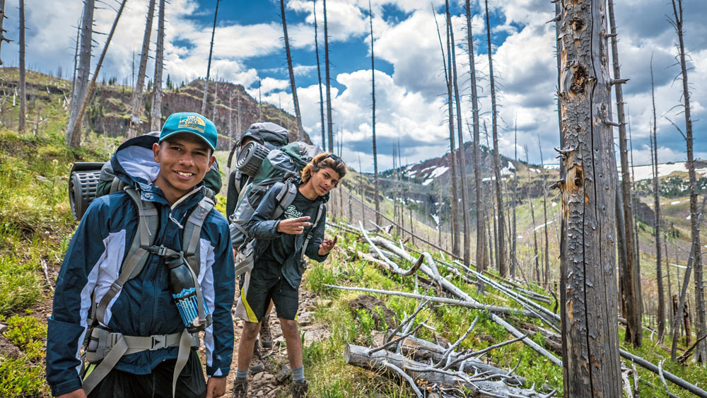 Young adventurers hike along a Colorado trail during an outdoor adventure program with Big City Mountaineers.