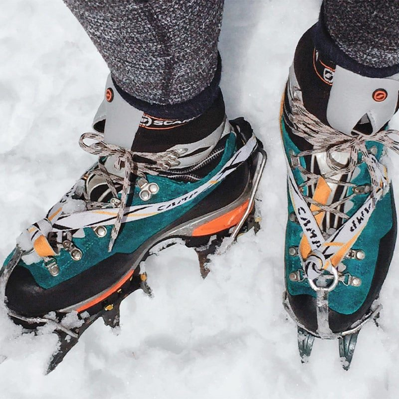 A student puts on crampons during an equipment lesson on a Mountaineering Basics class near Denver, Colorado.
