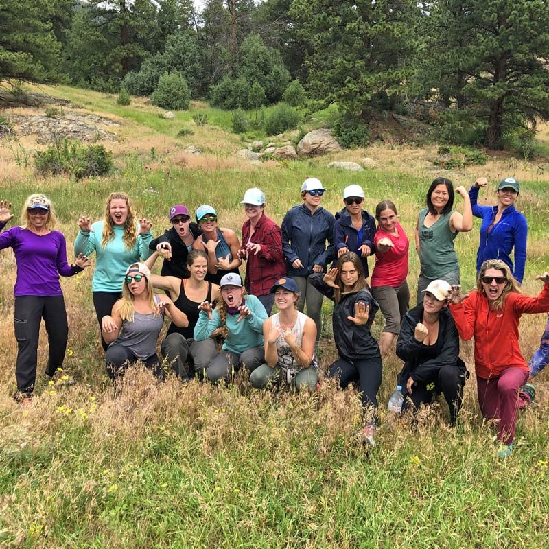 A corporate team from the outdoor industry poses after a day of hiking and team building activities in Estes Park, Colorado.