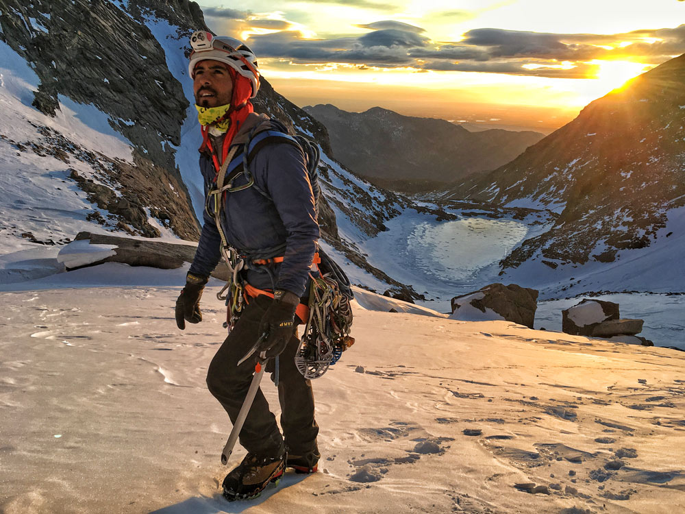 Japhy Dhungana, an AMGA Certified Rock Guide, approaches The Diamond on Longs Peak.