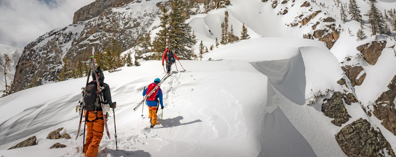 A group of backcountry skiers travel through avalanche terrain on their way to ski a line in Rocky Mountain National Park.