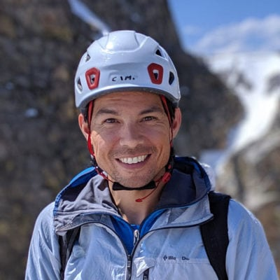Colorado Mountain School Instructor and AMGA Rock Guide, Jesse Ramos, is all smiles on an alpine climb in Colorado.