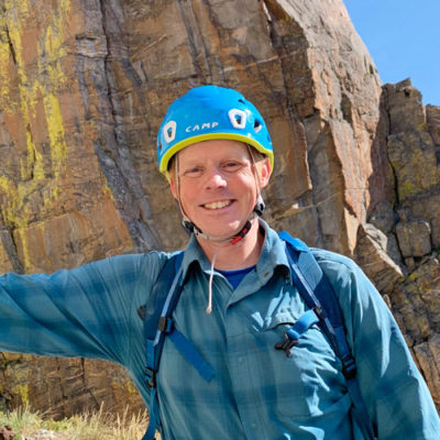 Ron Funderburke, Director of Education at Colorado Mountain School, is all smiles on a splitter day at the crag.