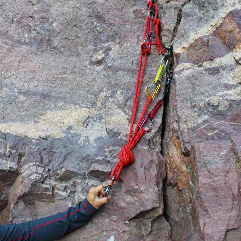 An example of a typical, advanced rock climbing anchor that might be used on a trad climb.