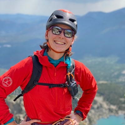 Colorado Mountain School Guide, Megan Yingling, hangs at a belay station on a ledge in Eldorado Canyon State Park.