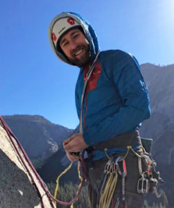 AMGA Rock Guide, Adam Fisher, racks gear for the next pitch on a big wall climb in Yosemite Valley.