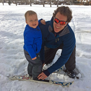 Colorado Mountain School Owner and CEO, Russell Hunter, teaches his young son how ski.