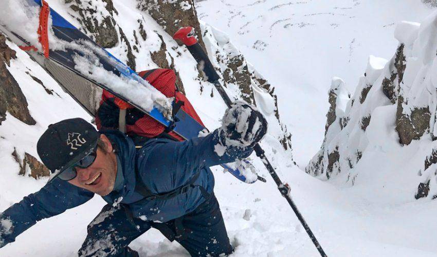Colorado Mountain School Guide, Matt Hartman, bootpacks up a steep couloir on a spring morning in Rocky Mountain National Park.